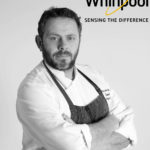 Tony Carty with Whirlpool Logo
